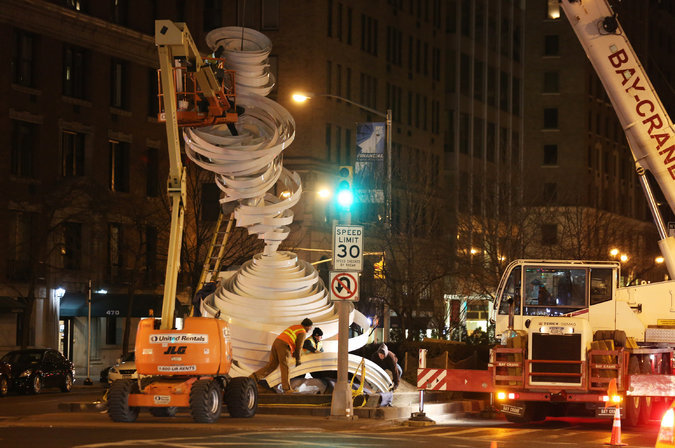 """""""Cyclone Twist,"""" an Alice Aycock art installation, being assembled along Park Avenue. (Credit: Richard Perry/The New York Times)"""