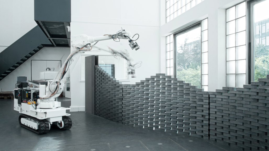 The In-situ Fabricator putting another brick in the wall (photo via dfab.ch)