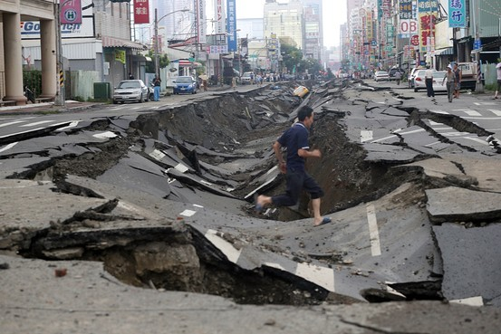 Underground explosions in Kaohsiung, Taiwan's second-largest city, caused deep craters in roads. Zuma Press, image via online.wsj.com.