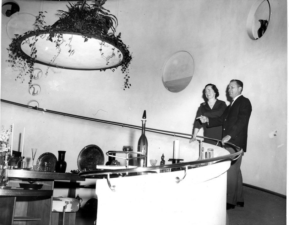 """The V.C. Morris gallery as it appeared in 1960 when Allan Adler — described by The Chronicle as a """"famed silversmith"""" — purchased the shop from the estate of the owners who hired truly famed architect Frank Lloyd Wright to transform the space in the late 1940s. Adler is on the right. (Berge Studio) Image via sfchronicle.com."""