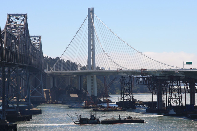 A view of the suspension-bridge section of the East Span of the San Francisco-Oakland Bay Bridge. A replacement for the 1936 original bridge (left in photo), it was designed by a joint venture of T.Y. Lin International and Moffatt & Nicholls Engineers. It will open Sept. 3. Photographer: James S. Russell/Bloomberg