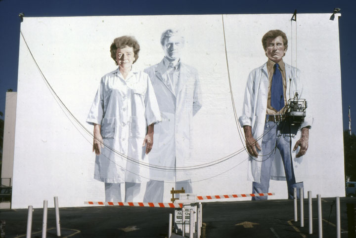 """Muralist Kent Twitchell working on """"Holy Trinity with the Virgin"""" on Wilshire Blvd in 1978. (Anne Laskey/Courtesy LA Public Library)"""
