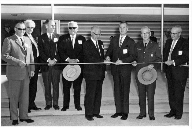 This undated photo provided by the National Park Service shows architect Richard Neutra, second from left, and unidentified others at a ribbon-cuttting at the Petrified Forest National Park visitors compound
