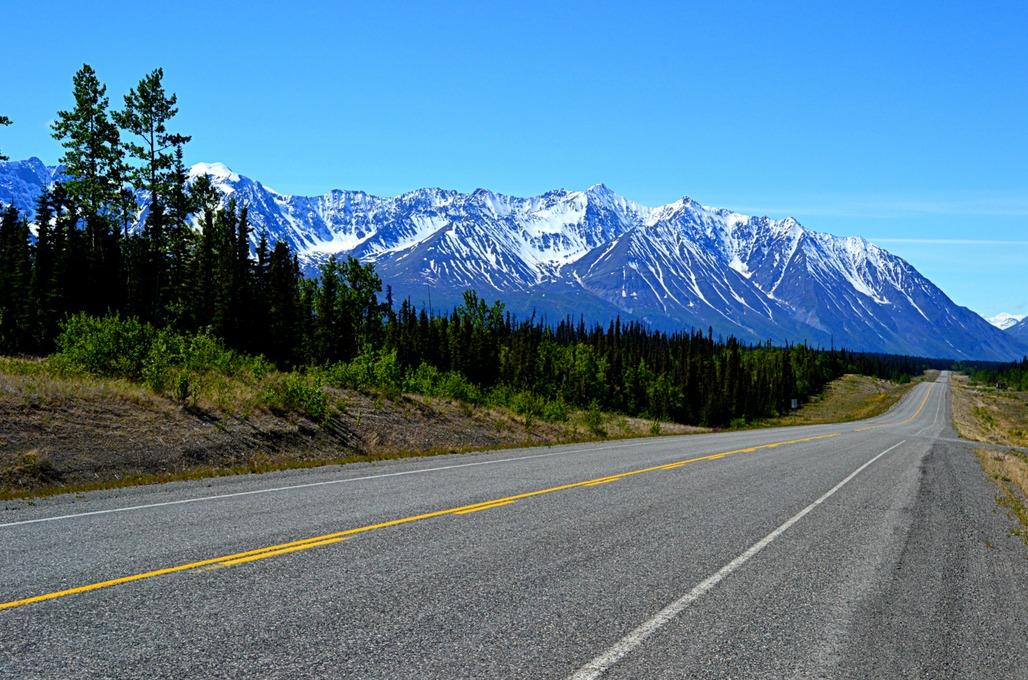 The Alaska Highway across the Yukon. Photo via wheretherobertmeetstheroad.com