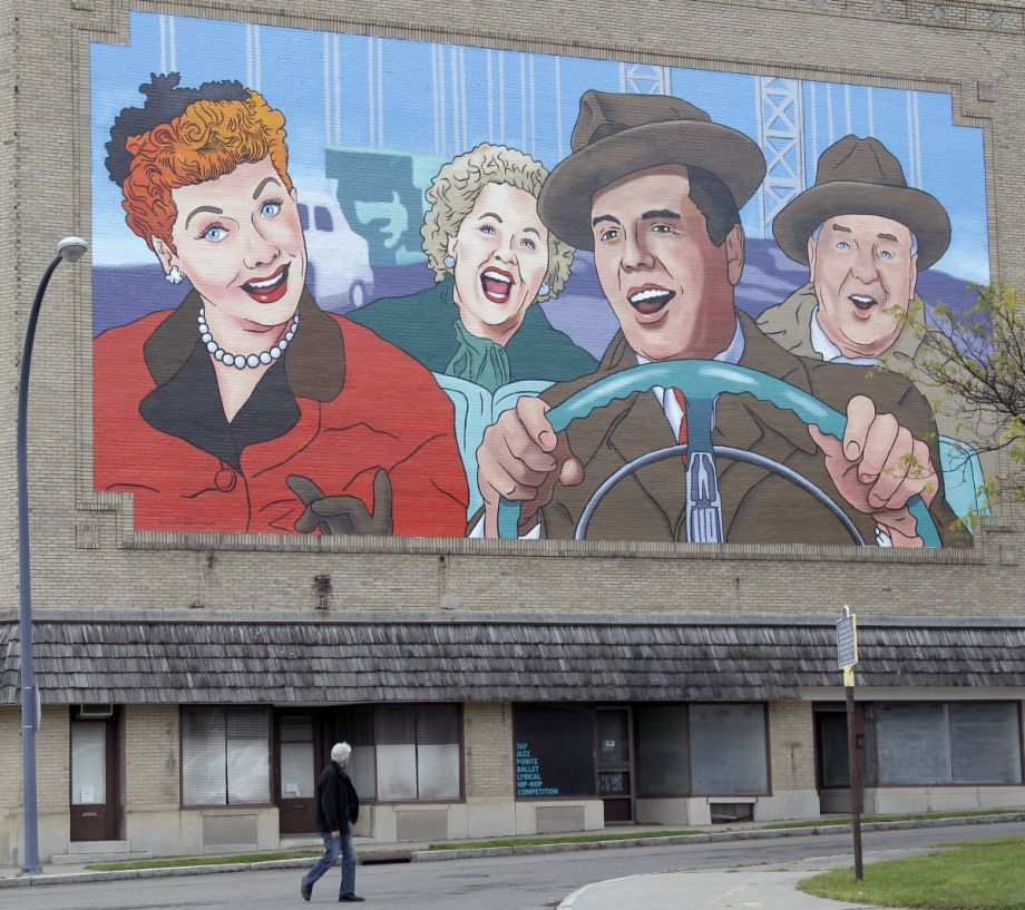 "An ""I Love Lucy"" mural on a building in Jamestown, N.Y. The popular TV show signaled a shift in American living from cities to suburbs. (AP Photo/David Duprey)"