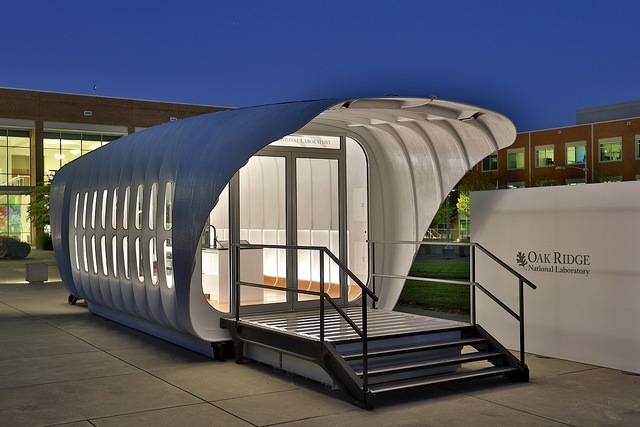 The AMIE platform comprises a 3D-printed house that can power its 3D printed car counterpart, and vice-versa. Credit: ORNL