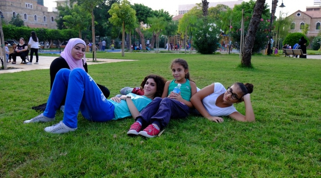 """Fifteen-year old Noura (second from left) lives near the newly restored Sanayeh Garden in Beirut and jogs here regularly. """"You can feel the air quality change as you enter the park,"""" she says. (Photo: Reine Chahine, via citiscope.org)"""