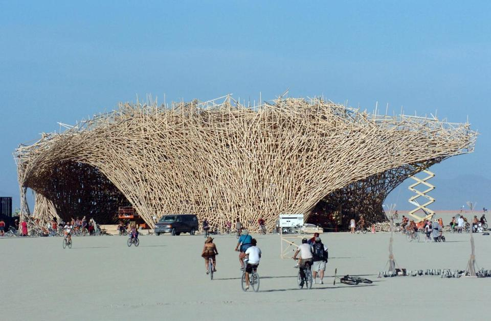 """Conceptual artist Arne Quinze designed a 15-story structure named """"Uchronia"""" at the Burning Man festival in Black Rock City, Nev., in 2006. The structure, which was quickly dubbed """"The Belgian Waffle,"""" was burned during the closing hours of the annual event. (The Boston Globe; Photo: Ron Lewis/Associated Press/File)"""