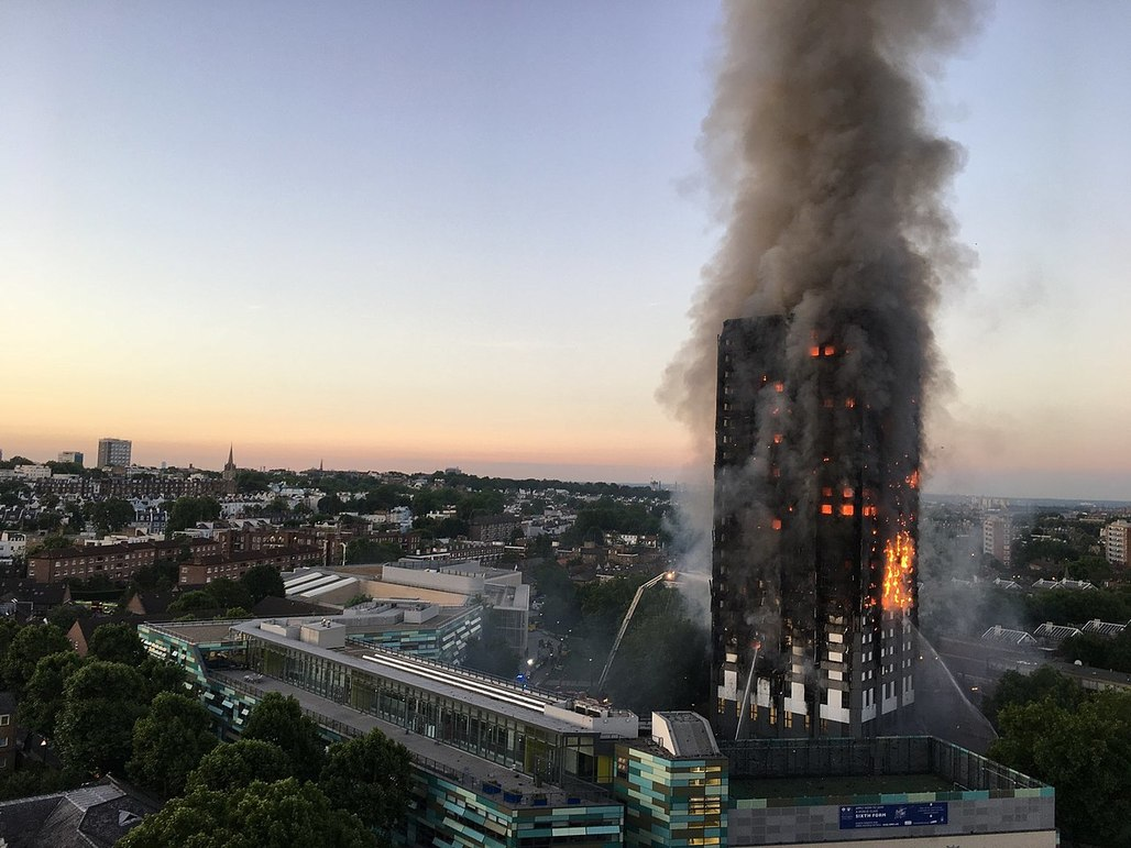 Flammable cladding is believed to have caused the tragic fire at London's Grenfell Tower on June 14, 2017 that killed at least 80 people and injured over 70. Photo: Natalie Oxford; Image via Wikipedia.