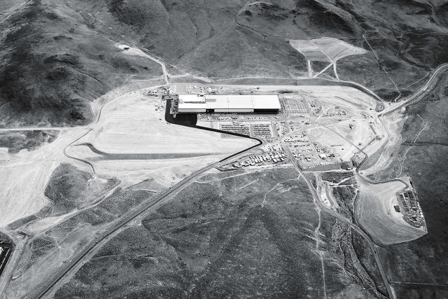 Once completed, Tesla's Gigafactory in the Nevada desert will be the second-largest building in the world by volume. (Image via fastcompany.com)
