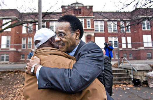 Before a Monday news conference at the Bancroft School site, Rep. Emanuel Cleaver embraced Mike Richardson, who lives near the school.