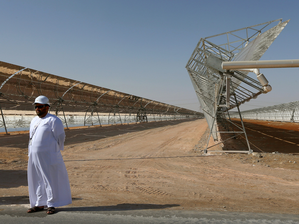 Rows of parabolic mirrors at the Shams 1 plant in Abu Dhabi. (Marwan Naamani/AFP/Getty Images)