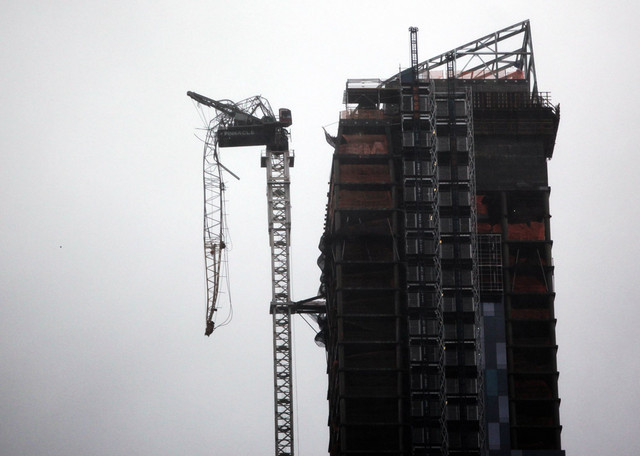 A crane attached to One57 is seen partially collapsed at 157 W. 57th St. in New York. (Photographer: Allison Joyce/Getty Images)