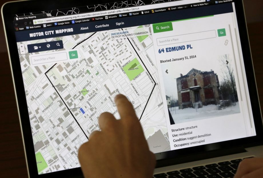 """Detroit residents can now use a """"blexting"""" app — short for blight texting — to send photos about derelict properties to a mapping database in Detroit. (AP Photo/Carlos Osorio; via nextcity.org)"""