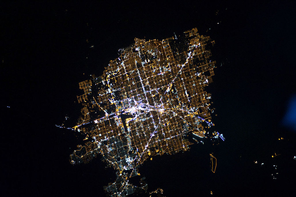 Glittering Las Vegas at night surrounded by the dark, dark desert. (Photo: NASA Earth Observatory)