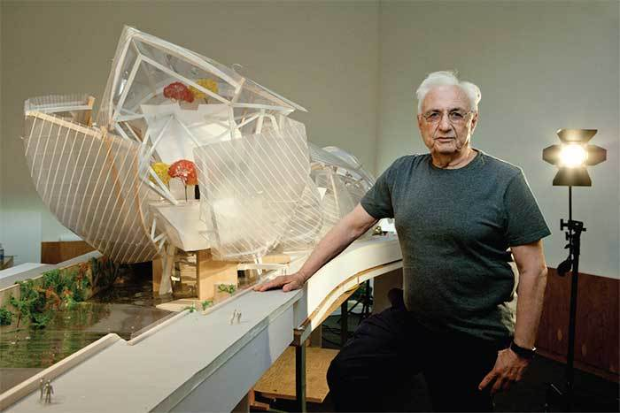 """Sailing away: Frank Gehry with a model of the Fondation Louis Vuitton—""""it looked like a regatta to me"""". (The Art Newspaper; Photo: © Sébastien MICKE/PARISMATCH/SCOOP)"""