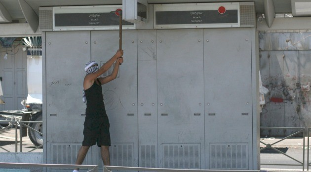 Palestinian youth attacking a light rail station in Jerusalem. Image via the Jewish Daily Forward