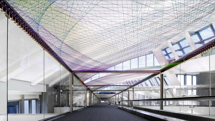 "The installation ""ΣLAX"" by artist Pae White is one of three public art commissions recently unveiled to the public at Los Angeles International Airport. (Image: PanicStudio L.A.; via latimes.com)"