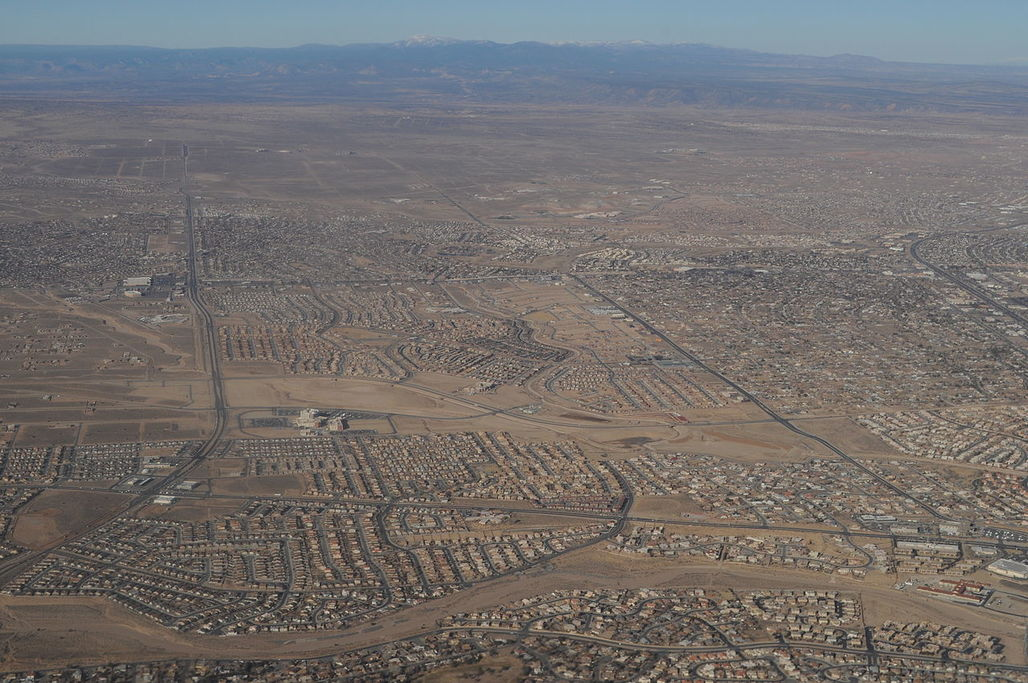 """Antonia Malchik argues in her aeon essay, The end of walking, that """"Americans have been stripped of the right to walk, challenging their humanity, freedom and health."""" (Aerial photo of Albuquerque, New Mexico by Joe Mabel/Wikimedia Commons.)"""