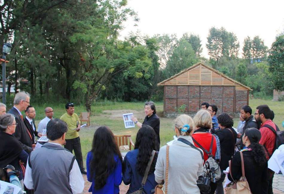 The photo shows Shigeru Ban presenting a Nepal House Project prototype in Kathmandu after the devastating 2015 Nepal earthquake. (Photo courtesy of VAN - Voluntary Architects' Network)