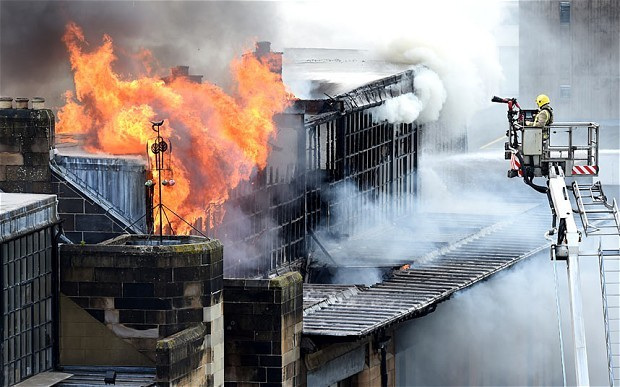 Firefighters tackle the blaze at the famous Glasgow School of Art. (The Telegraph; Photo: CRAIG WATSON/SNS)