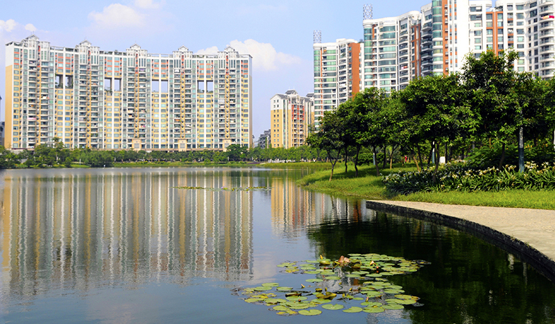 Modern luxury residential buildings stand lakeside in Foshan, in the Chinese province of Guangdong. (via urbanland.uli.org)