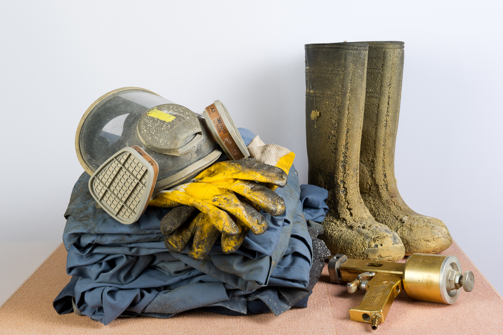 Protective clothing, breathing mask, and spray gun used when applying polyurethane insulation foam. Courtesy of ISOwit; Belgium, 2013.