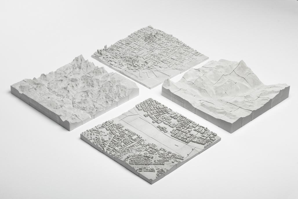 Planbureau's topographical, 3D concrete puzzles of San Francisco, The Grand Canyon, Budapest, and Zermatt.