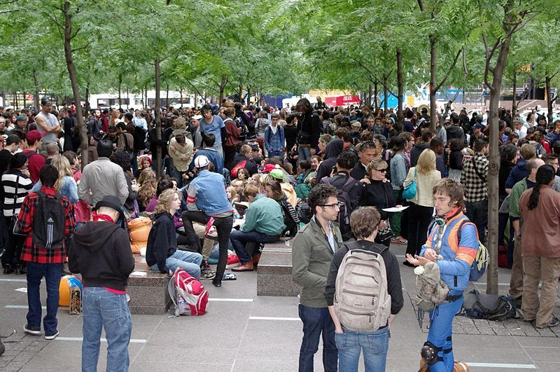 Zuccotti Park is home to two sculptures, including Mark di Suvero's Joie de Vivre, seen here in the background via Wikimedia Commons