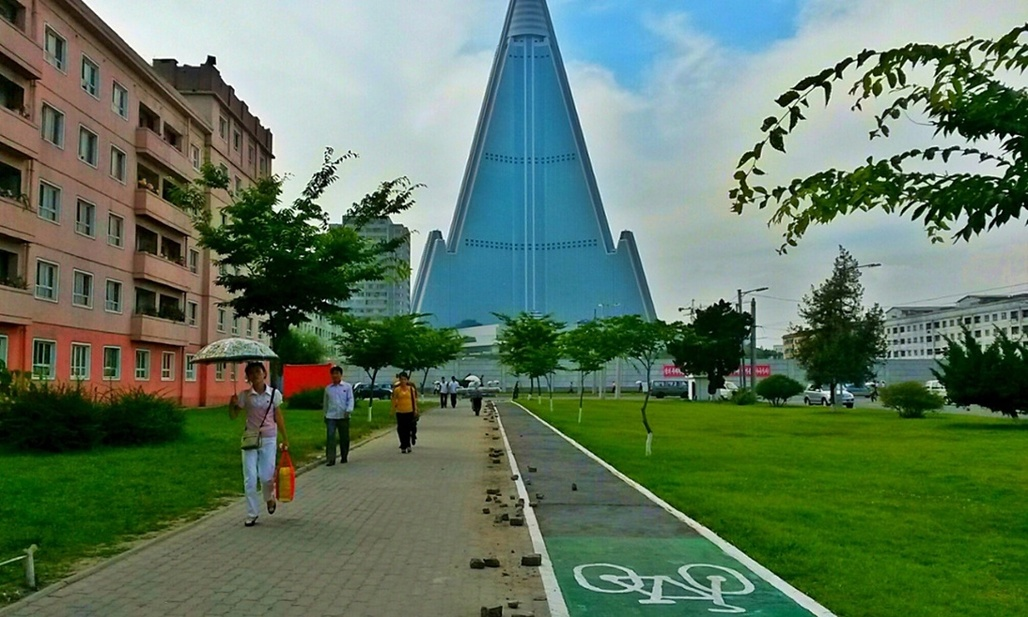 While still not a very common mode of transportation, bicycles are now getting dedicated lanes in Pyongyang to reduce the number of collisions with pedestrians. (Photo: Handout/Reuters; Image via theguardian.com)