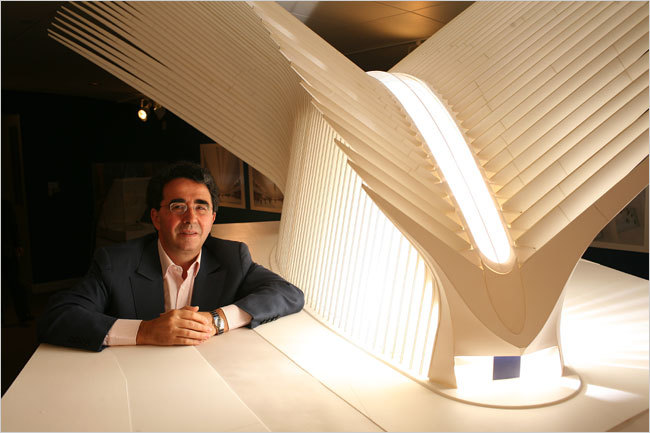 The architect with a model for his WTC transportation hub, currently costing nearly $4 billion. (Image via forum.skyscraperpage.com)
