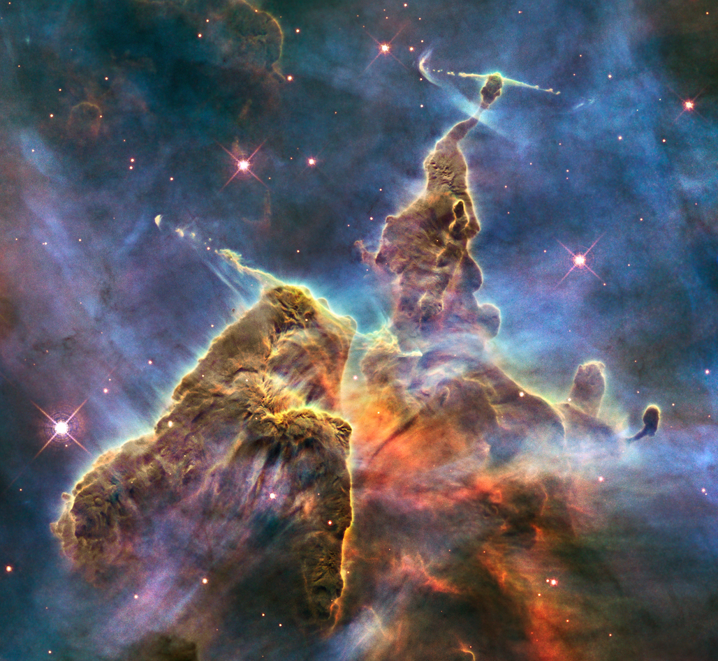 Mystic Mountain, a region in the Carina Nebula. Image by the Hubble Space Telescope, via Wikipedia.