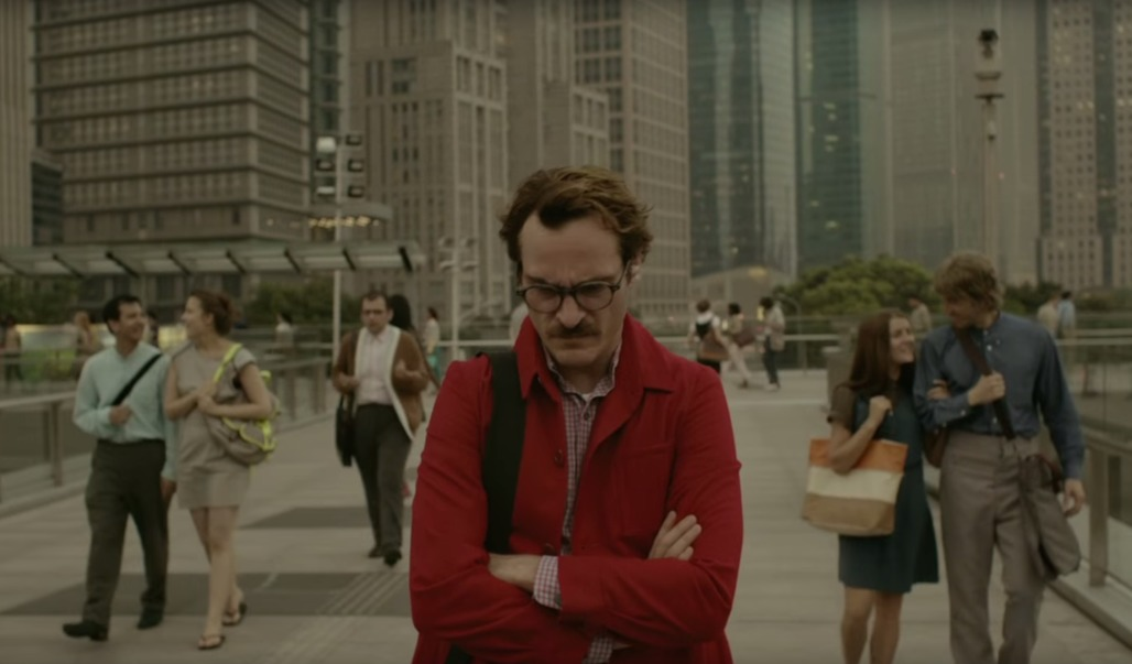"""Joaquin Phoenix walks through a future Los Angeles, gloomy in spite of the lack of cars and efficient public transport. Image from """"Her"""""""