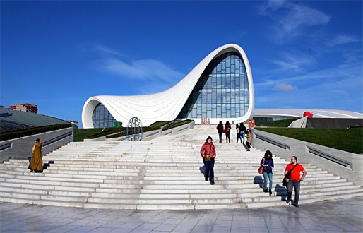 """The Heydar Aliyev Center in Azerbaijan's capital of Baku has earned worldwide recognition for its Zaha Hadid design — as well as outrage about reported human rights violations. Calvert Journal writer Anya Filippova calls it """"the most celebrated piece of modern architecture in the post-Soviet world."""" (Photo: ljubar; Image via calvertjournal.com)"""
