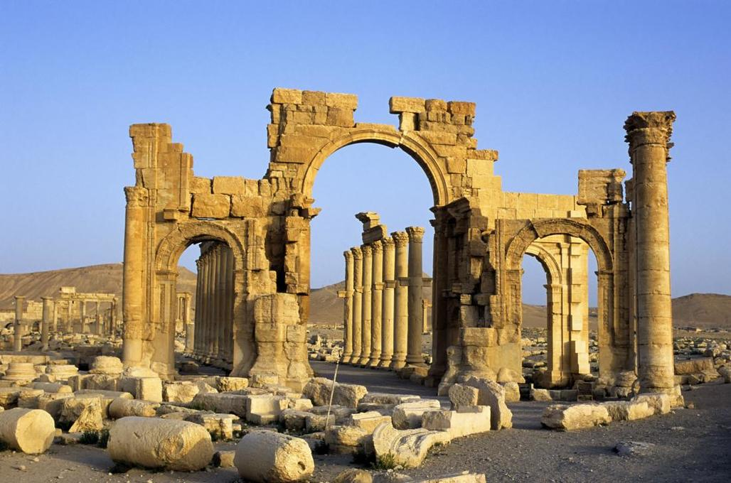 Using photographs, the destroyed Palmyra arch will be recreated via 3D printing (image of Syrian heritage site via time.com)