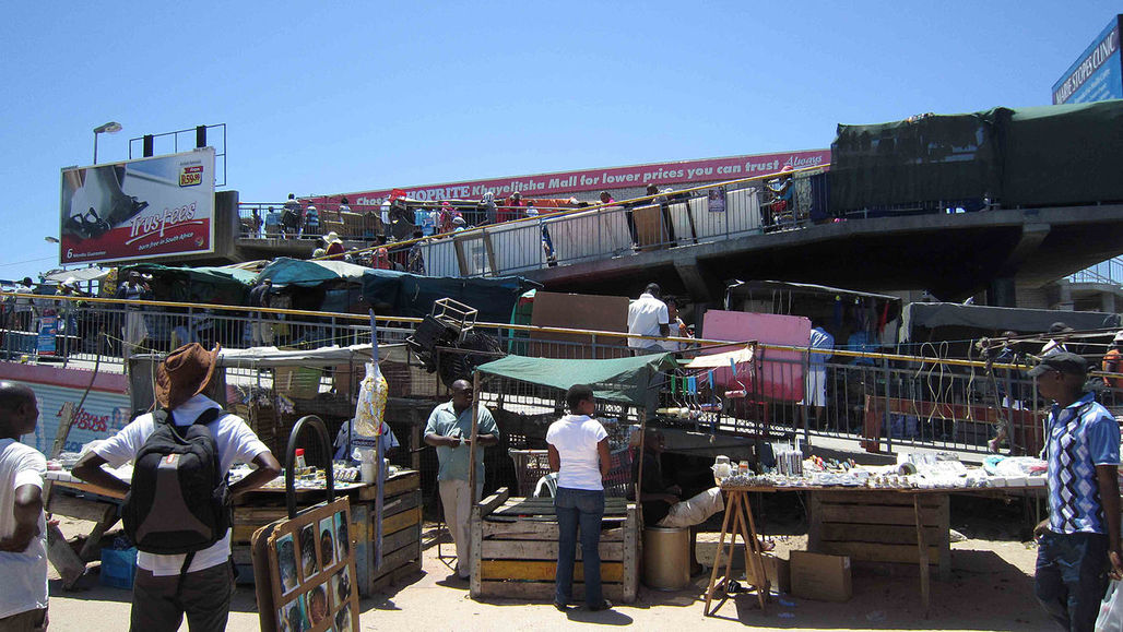 Informal workers conducting business outside of the metrorail station of Khayelitsha township, South Africa. (Image via Wikipedia)
