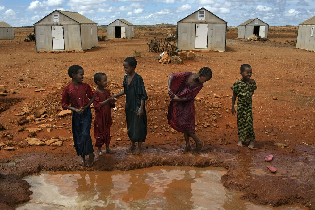 "Families in front of ""Better Shelters"" at the Hilawyen refugee camp in Dollo Ado, Ethiopia."