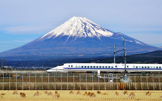 A bullet train passing Mt. Fuji in Japan. Credit: Fotolia/AP via the Telegraph