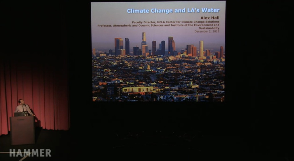 """Alex Hall presenting on the role of climate change in the future of water in Los Angeles during """"Next Wave: Thriving in a Hotter Los Angeles"""" at the Hammer Museum. Credit: Next Wave / the Hammer Museum"""