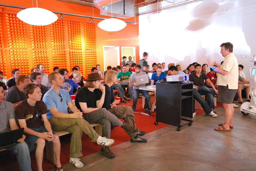 Paul Graham, one of the founders of Y Combinator, speaking at their headquarters. Image via wikimedia.org