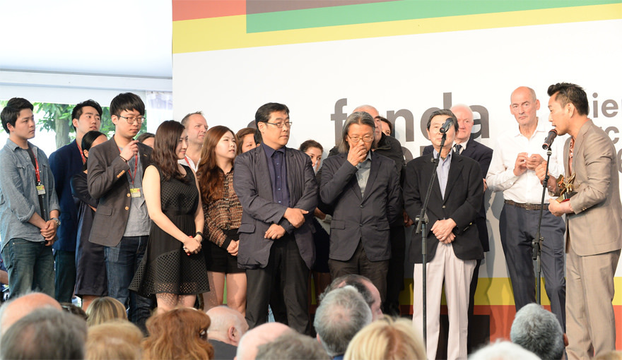 Korean pavilion commissioner Minsuk Cho accepting the Golden Lion award for Best National Participation at the 2014 Venice Biennale awards ceremony. Photo © 14th International Architecture Exhibition