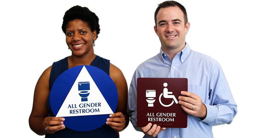 Sam Killermann (right) designed this all gender restroom sign, which is uncopyrighted and available (sometimes freely) from the company My Door Sign. Credit: Sam Killermann