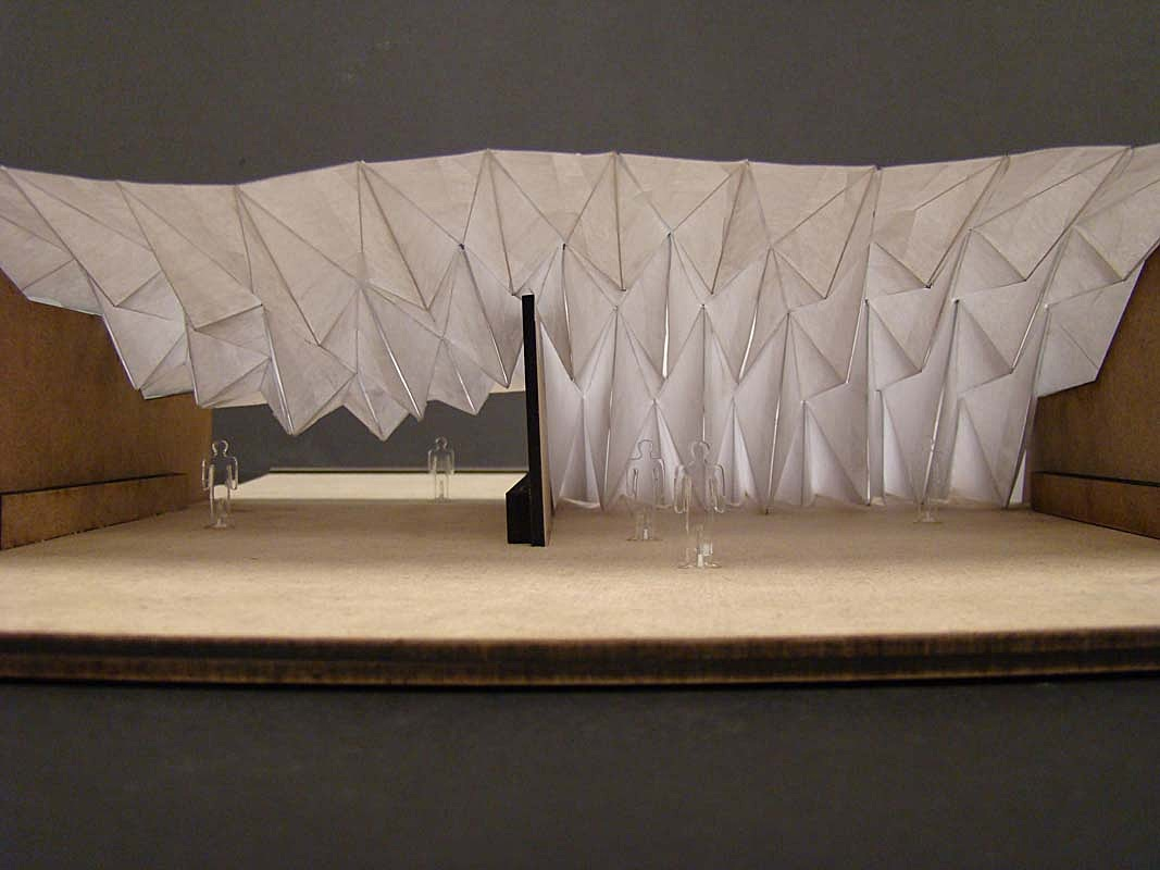 Testig the sturcture, a dynamic model of the dam's folding system.