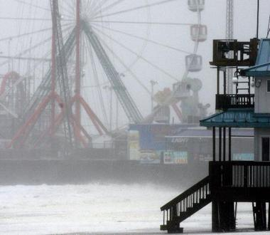 A 50-foot section of the Funtown Pier in Seaside Heights, seen in the background above, has collapsed. (Photo: David Gard/The Star-Ledger)