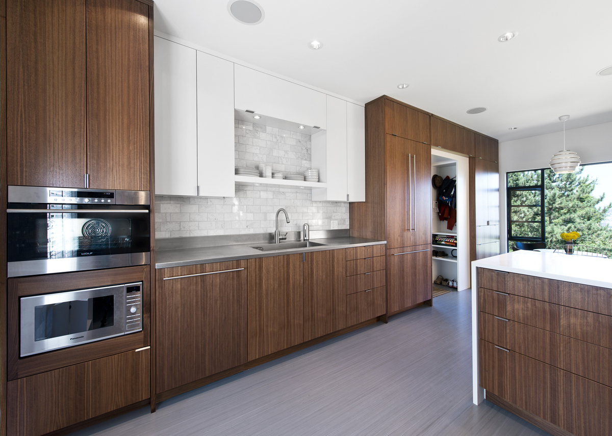 Kitchen walnut wall with concealed appliances