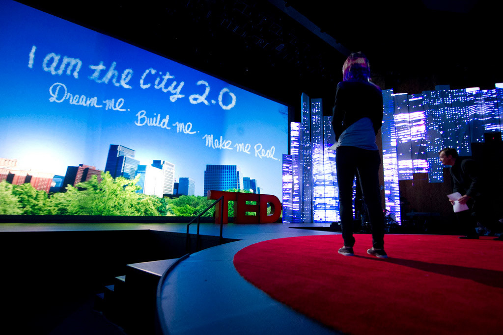 TED's Amy Novogratz watches the video play onstage at TED2012 (Photo: James Duncan Davidson)