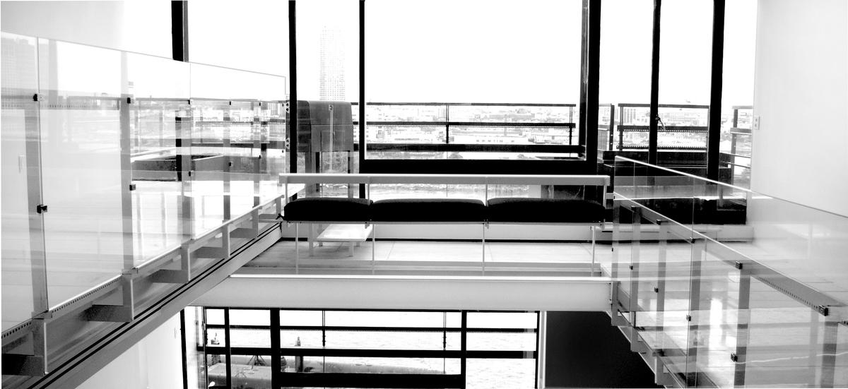 Kitchen view overlooking living room mezzanine