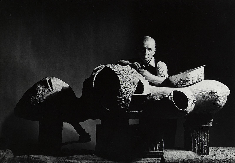 Frederick Kiesler with a model for an