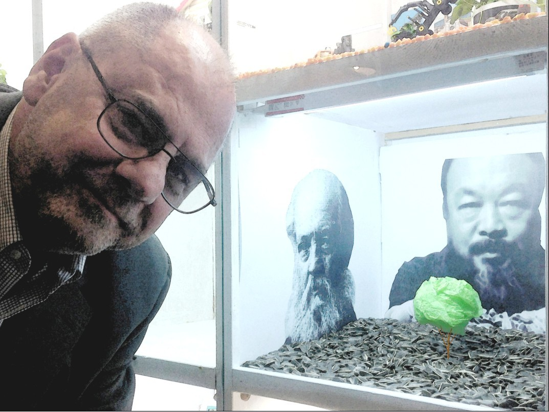Barry poses with an Ai Weiwei-inspired sculpture he created for an art competition in his company