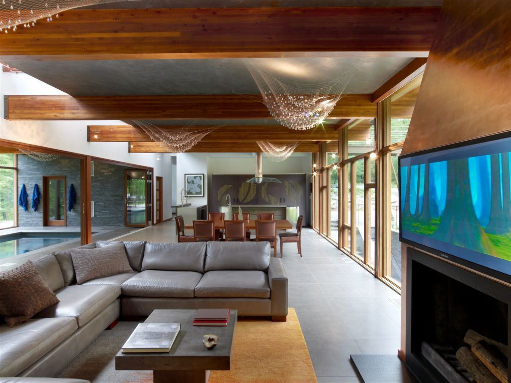 Open plan includes living area, dining area and pool area